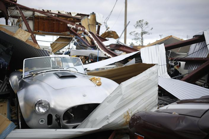 <p>A vintage Shelby Cobra vehicle sits surrounded by debris at a damaged warehouse after Hurricane Michael hit in Panama City, Fla., on Thursday, Oct. 11, 2018. (Photo: Luke Sharrett/Bloomberg via Getty Images) </p>