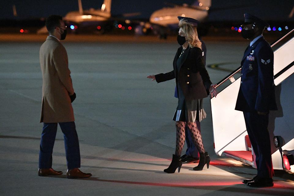 US First Lady Jill Biden wearing fishnet style patterned tights and mini skirt