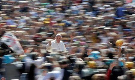 Pope Francis gives the thumb up as he arrives to lead the weekly audience in Saint Peter's Square at the Vatican May 18, 2016. REUTERS/Max Rossi