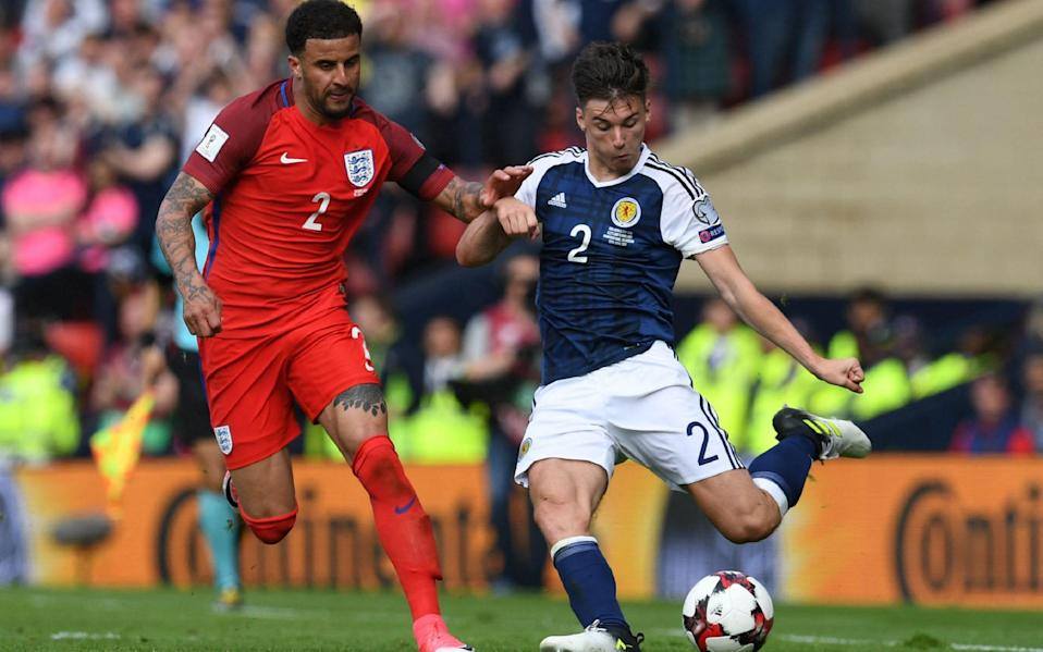 Kieran Tierney (right) in action against England back in 2017 - AFP