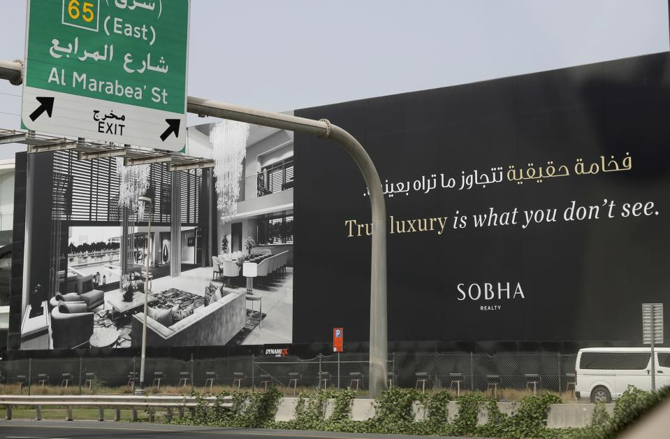 A billboard advertises a luxury residential project along a highway in Dubai, United Arab Emirates, Wednesday, May 5, 2021. Foreign buyers flush with cash have flooded the high-end property market in Dubai even as coronavirus vaccines roll out unevenly across the world and waves of infections force countries to extend restrictions. It's one of the few places in the world where they can dine, shop and do business in person. (AP Photo/Kamran Jebreili)