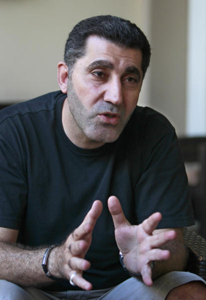 In this Wednesday, July 10, 2013 photo, Ali Rashid, 45, a Shiite who was expelled from the UAE in 2011, speaks with Hassan Alayan, unseen, at a cafe in Beirut, Lebanon, Wednesday, July 10, 2013. Long considered by authorities as a security threat, hundreds of Shiites have been quietly expelled from the United Arab Emirates over the past few years on suspicion of being supporters of Hezbollah. Diplomats and Shiite families in Lebanon say deportations have surged in the past few months after the militant group group publicly joined the civil war in Syria on the side of President Bashar Assad, an arch enemy of the Gulf's rulers.(AP Photo/Bilal Hussein)