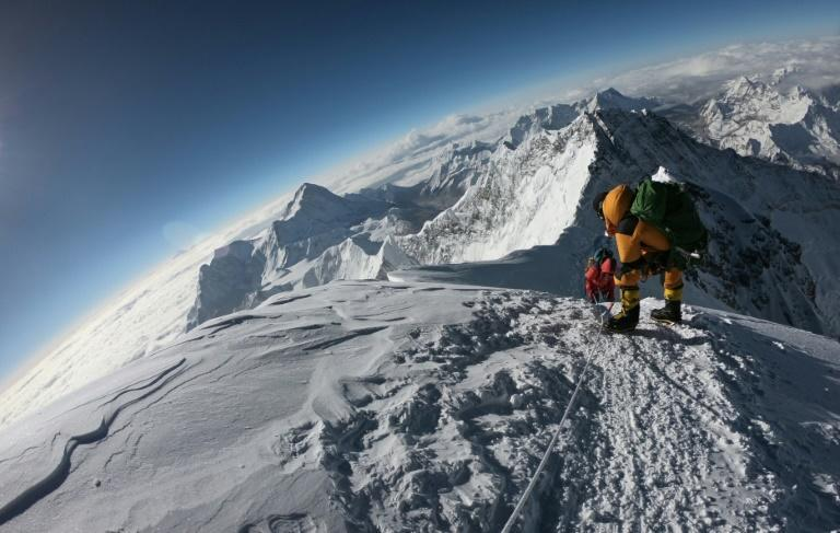 Mountaineers make their way to the summit of Mount Everest, as they ascend on the south face from Nepal on May 17, 2018