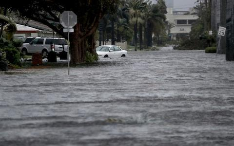 Floodwaters cover part of 3rd Ave in Dania Beach, east of U.S. Route 1, Florida - Credit: AP