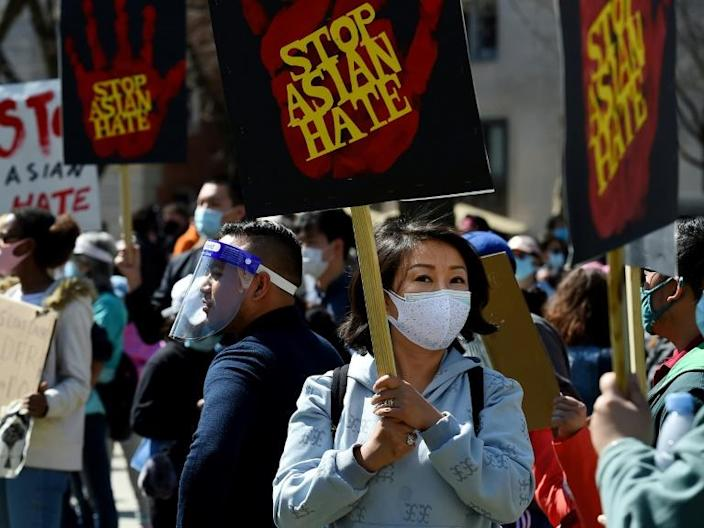 People gather at a rally in Washington to demand safety and protection of Asian communities in the aftermath of deadly shootings in the Atlanta area