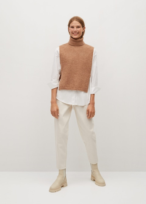 """Love knitwear for fall? Then you'll love this ultra-soft turtleneck dickey. <br> <br> <strong>Mango</strong> Vent Gilet, $, available at <a href=""""https://go.skimresources.com/?id=30283X879131&url=https%3A%2F%2Fshop.mango.com%2Fus%2Fwomen%2Fcardigans-and-sweaters-sweaters%2Fvent-gilet_77024404.html"""" rel=""""nofollow noopener"""" target=""""_blank"""" data-ylk=""""slk:Mango"""" class=""""link rapid-noclick-resp"""">Mango</a>"""