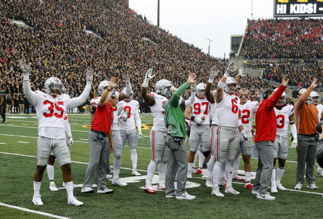 Ohio State's usual road uniform combination features gray pants and red numbers. (AP Photo/Charlie Neibergall)