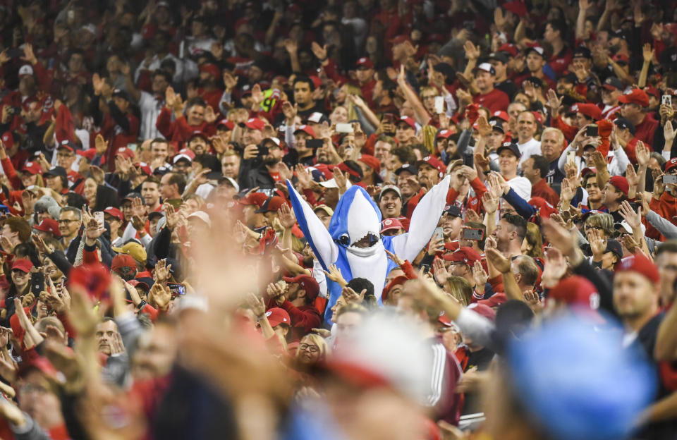 """Nats fans doing their """"Baby Shark"""" celebration during NLCS. (Photo by Toni L. Sandys/The Washington Post via Getty Images)"""