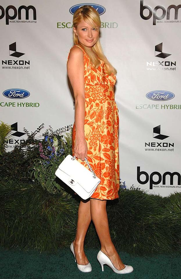 """Paris decides to pair her orange floral frock with a bright white purse and pumps. Jean-Paul Aussenard/<a href=""""http://www.wireimage.com"""" target=""""new"""">WireImage.com</a> - July 19, 2007"""