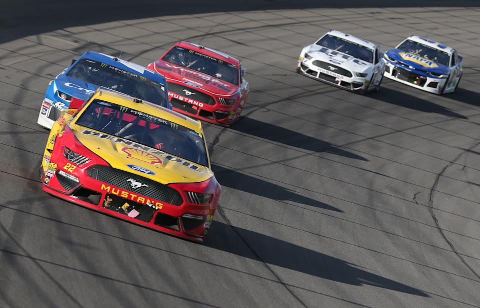 BROOKLYN, MICHIGAN - JUNE 10: Joey Logano, driver of the #22 Shell Pennzoil Ford, leads a pack of cars during the Monster Energy NASCAR Cup Series FireKeepers Casino 400 at Michigan International Speedway on June 10, 2019 in Brooklyn, Michigan. (Photo by Matt Sullivan/Getty Images)