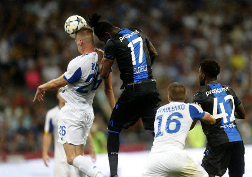 Brugge's Simon Deli, center, and Dynamo Kiev's Mykyta Burda head the balll during the Champions League third qualifying round, second leg, soccer match between Dynamo Kyiv and Club Brugge at the Olympiyskiy stadium in Kiev, Ukraine, Tuesday, Aug. 13, 2019. (AP Photo/Efrem Lukatsky)