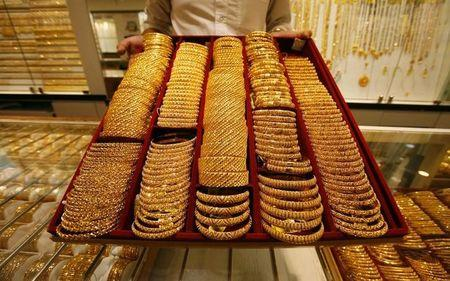 Salesman displays tray of gold at jewellery shop in Singapore