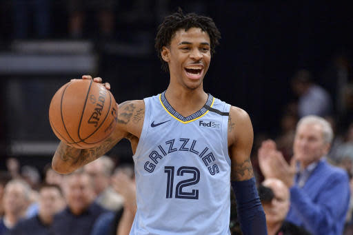 Memphis Grizzlies guard Ja Morant reacts while the Grizzlies run out the clock in an NBA basketball game against the Houston Rockets on Tuesday, Jan. 14, 2020, in Memphis, Tenn. (AP Photo/Brandon Dill)