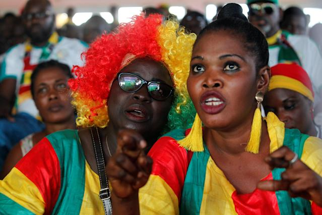 Soccer Football - World Cup - Group H - Japan vs Senegal - Abidjan, Ivory Coast - June 24, 2018. Senegalese fans react as they watch the match on a screen. REUTERS/Luc Gnago