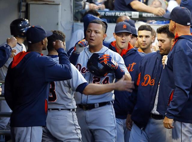 Detroit Tigers first baseman Miguel Cabrera (24) celebrates with teammates after hitting a home run in the fourth inning of a baseball game against the Chicago White Sox on Monday, June 9, 2014, in Chicago. (AP Photo/Jeff Haynes)