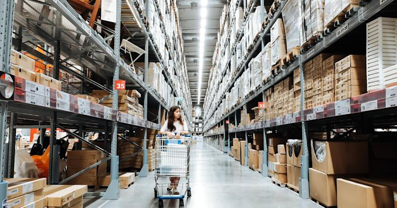 Woman shops in the warehouse section of Ikea.