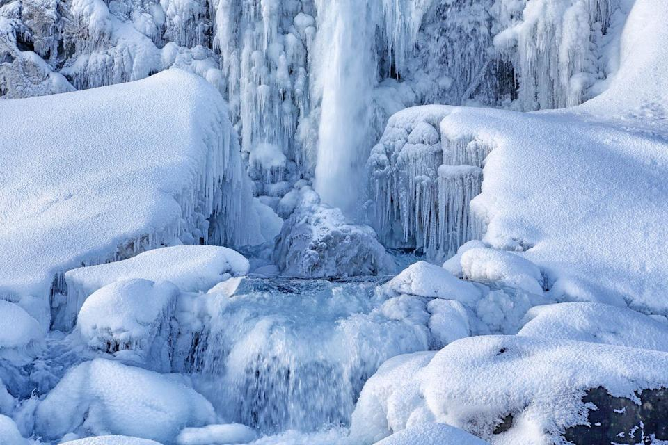 <p>Located in Þingvellir National Park, the pool at the base of the falls is filled with rocks and gets very icy in the winter...as you can see. </p>