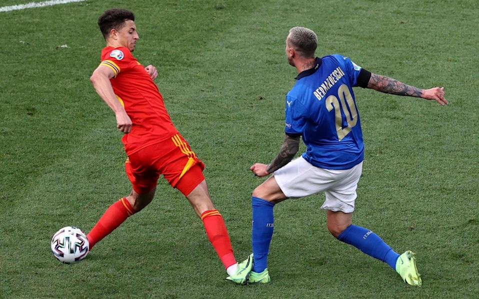Italy's Federico Bernardeschi, right is fouled by Wales' Ethan Ampadu, who was sent off for this - AP