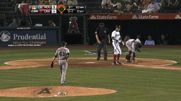 Home plate umpire plunks Astros' pitcher Brad Peacock with ill-timed throw