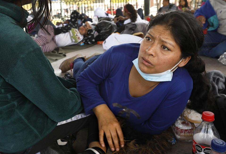 People rest in a central plaza in Reynoso, Mexico.