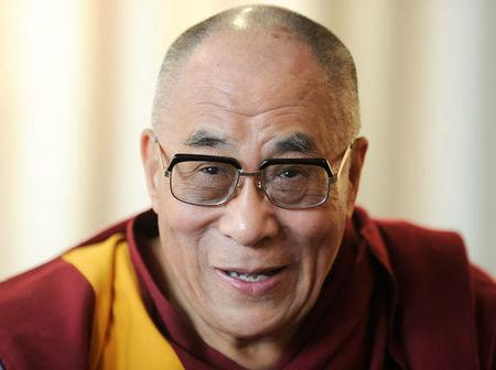 FILE PHOTO: Tibetan spiritual leader the Dalai Lama smiles during a news conference in Hamburg, August 21, 2011. REUTERS/Fabian Bimmer/File Photo