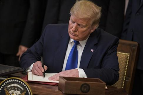US President Donald Trump signed the deal at the White House. Photo: Bloomberg