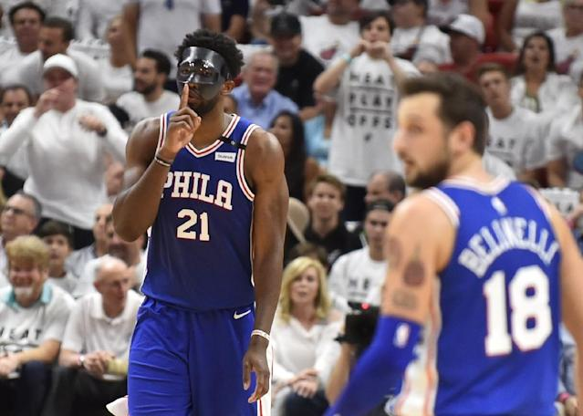 Joel Embiid of the Philadelphia 76ers reacts after hitting a three pointer in the second quarter against the Miami Heat at American Airlines Arena on April 19, 2018 (AFP Photo/Eric Espada)