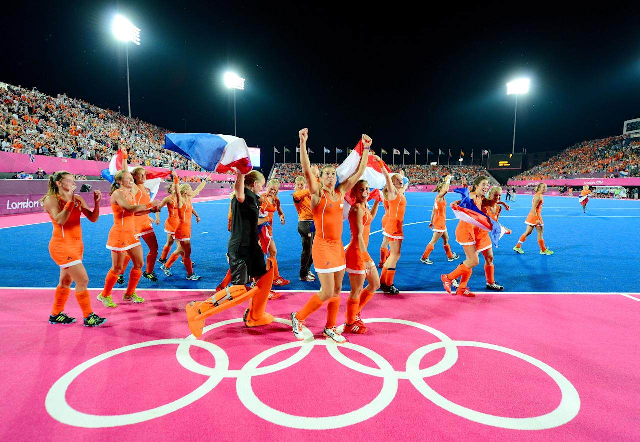 LONDON, ENGLAND - AUGUST 10:  Team Netherlands celebrate their 2-0 victory over team Argentina after the Women's Hockey gold medal match on Day 14 of the London 2012 Olympic Games at Hockey Centre on August 10, 2012 in London, England.  (Photo by Mike Hewitt/Getty Images)