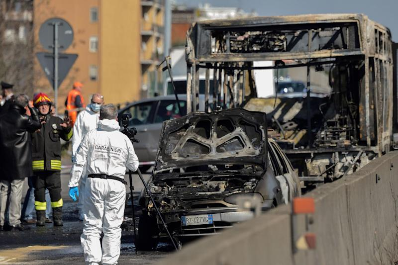 Forensic police and firefighters work by the wreckage of the school bus (AFP/Getty Images)