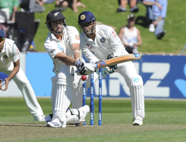 New Zealand's Tim Southee attempts against sweep in front of India's wicket keeper MS Dhoni on the 1st day of the 2nd cricket test at Basin Reserve in Wellington, New Zealand, Friday, Feb. 14, 2014. (AP Photo/SNPA, Ross Setford) NEW ZEALAND OUT