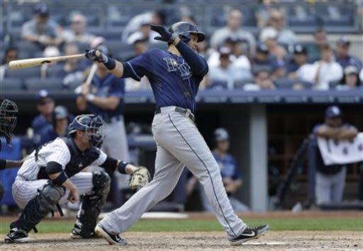 New York Yankees catcher Chris Stewart looks on as Tampa Bay Rays James Loney hits a seventh-inning two-run single in a baseball game on Sunday, June 23, 2013, in New York. (AP Photo/Kathy Willens)