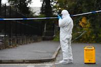A forensic officer at the scene on Russell Way in Crawley, West Sussex, after a 24-year-old man was fatally stabbed on Tuesday night.