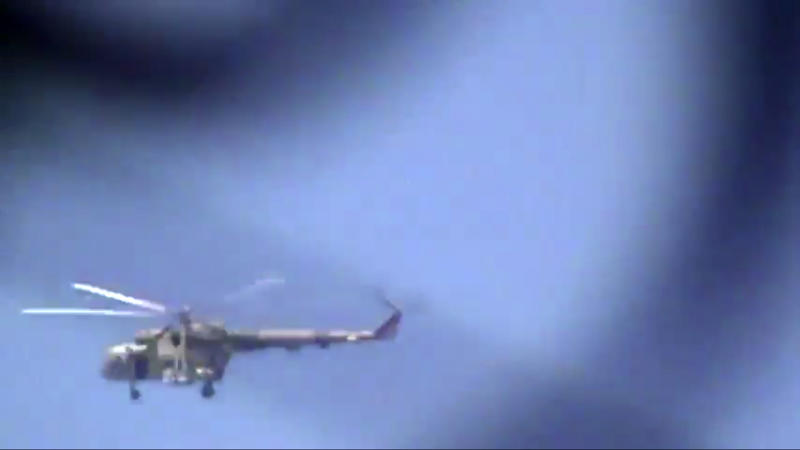 This image made from video provided by Shaam News Network Tuesday, July 17, 2012, purports to show a helicopter over Damascus, Syria. (AP Photo/Shaam News Network via AP video) THE ASSOCIATED PRESS HAS NO WAY OF INDEPENDENTLY VERIFYING THE CONTENT, LOCATION OR DATE OF THIS PICTURE.