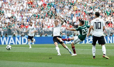 Mexico's Hirving Lozano scores their first goal. REUTERS/Carl Recine