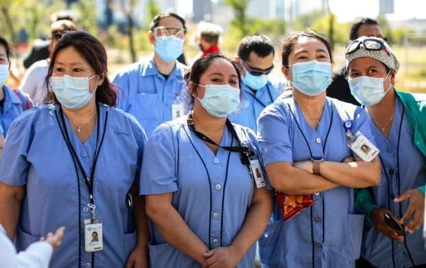 Nurses and supporters rallied in front of the Royal Alexandra hospital in Edmonton last month during a Day of Action information picket.   (Jason Franson/The Canadian Press - image credit)
