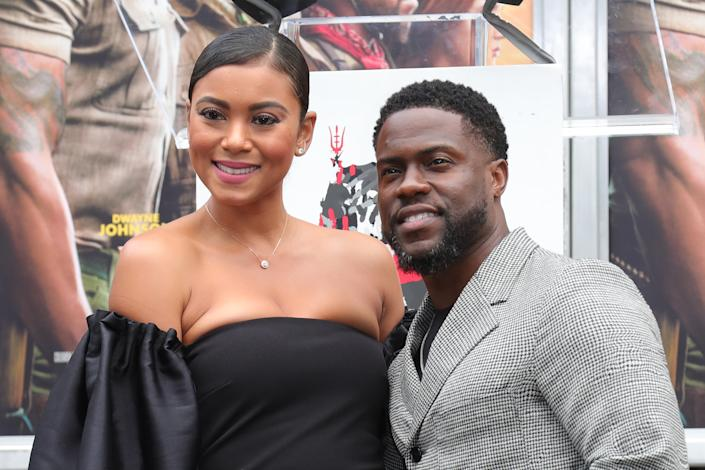 HOLLYWOOD, CALIFORNIA - DECEMBER 10: Kevin Hart (R) and wife Eniko Parrish pose as Hart is honored with a Hand And Footprint Ceremony at TCL Chinese Theatre on December 10, 2019 in Hollywood, California. (Photo by Leon Bennett/WireImage)