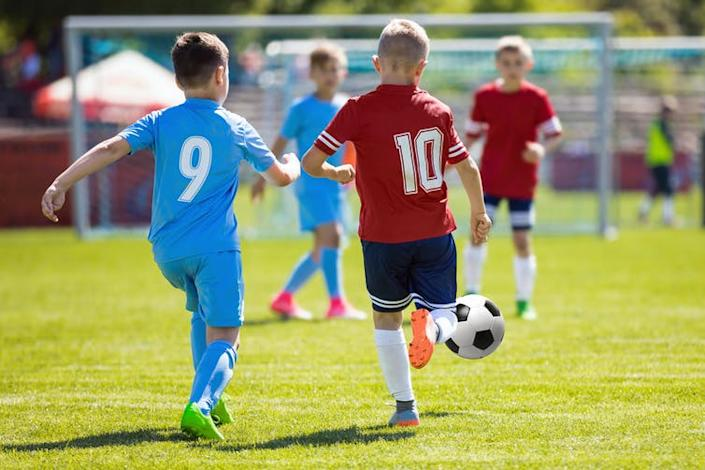 """<span class=""""caption"""">Football and other sports are often taken up by pupils in extra-curricular clubs.</span> <span class=""""attribution""""><a class=""""link rapid-noclick-resp"""" href=""""https://www.shutterstock.com/image-photo/running-soccer-football-players-footballers-kicking-792838930?src=qACbtUCJbM1KUQNZvqfcsg-1-5"""" rel=""""nofollow noopener"""" target=""""_blank"""" data-ylk=""""slk:Shutterstock/matimix"""">Shutterstock/matimix</a></span>"""