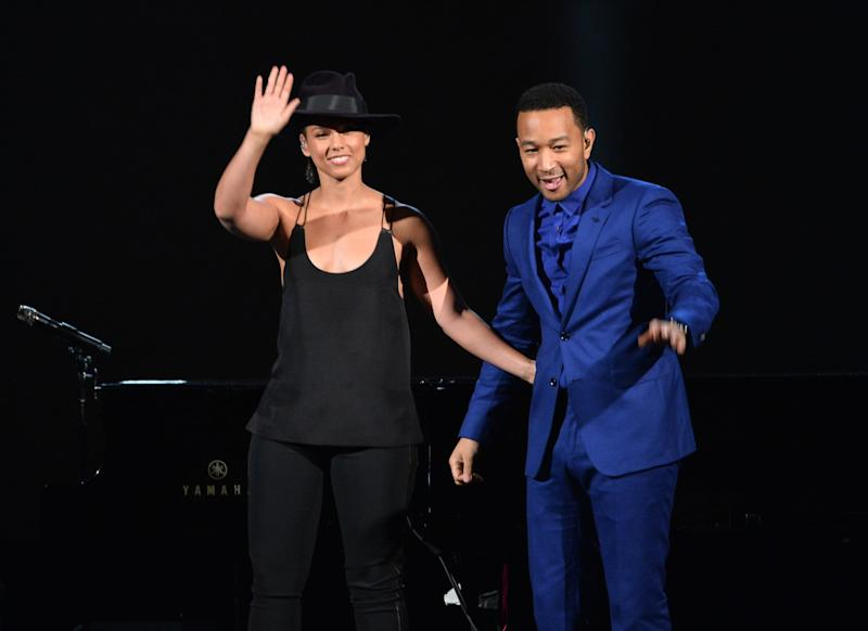 LOS ANGELES, CA - JANUARY 27: Recording artists Alicia Keys (L) and John Legend perform onstage during
