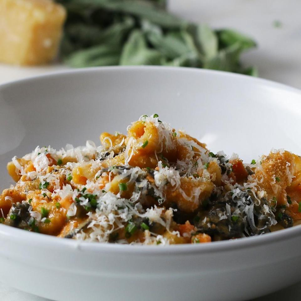 Bowl of penne topped with Parmesan cheese