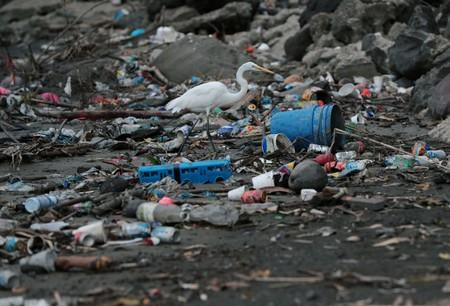 Plastic waste pile and debris are seen up near the beach in Panama City