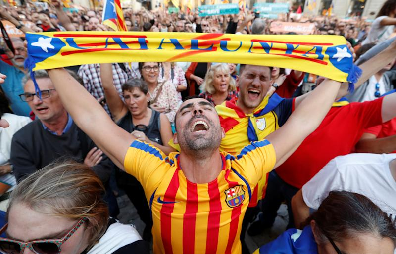People react at Sant Jaume Square in Barcelona after the Catalan regional parliament declares independence from Spain. (Yves Herman / Reuters)