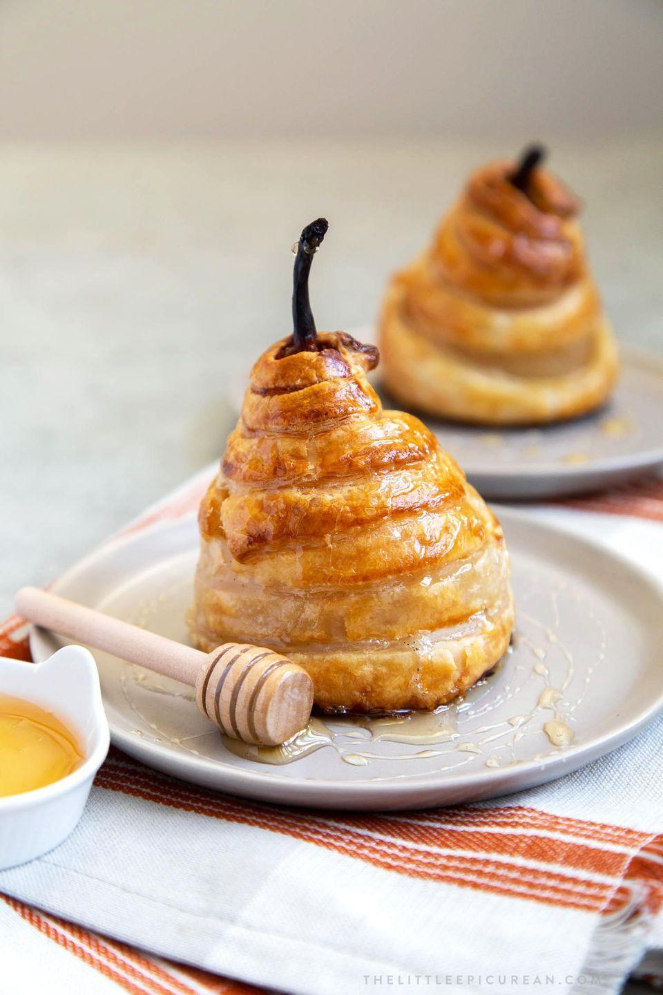 """<p>Need an elegant winter dessert for a dinner party? Poach pears in a sweet vanilla cinnamon liquid, then bake each one in a flaky puff pastry crust.</p><p><a href=""""https://www.thelittleepicurean.com/2019/11/poached-pear-puff-pastry.html"""" rel=""""nofollow noopener"""" target=""""_blank"""" data-ylk=""""slk:Get the recipe"""" class=""""link rapid-noclick-resp"""">Get the recipe</a>.</p>"""