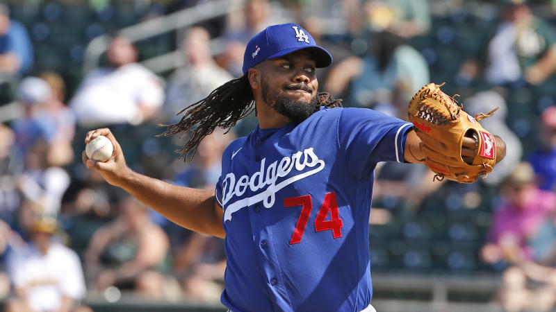 Los Angeles Dodgers' Kenley Jansen (74) pitches during a spring training baseball game, Thursday, March 5, 2020, in Mesa, Ariz. (AP Photo/Sue Ogrocki)