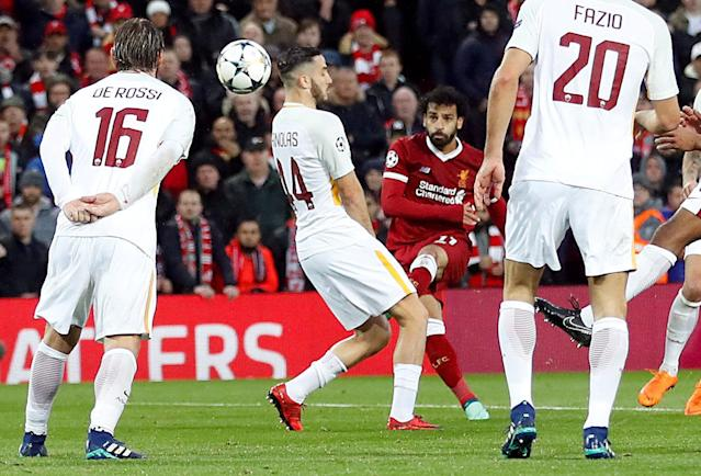 Soccer Football - Champions League Semi Final First Leg - Liverpool vs AS Roma - Anfield, Liverpool, Britain - April 24, 2018 Liverpool's Mohamed Salah scores their first goal Action Images via Reuters/Carl Recine TPX IMAGES OF THE DAY