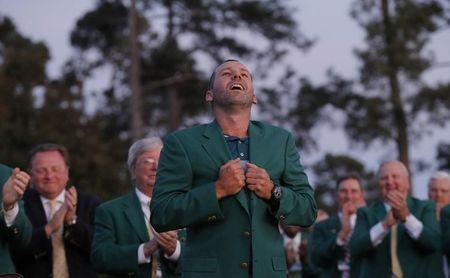 Sergio Garcia of Spain puts on his green jacket after winning the 2017 Masters in Augusta