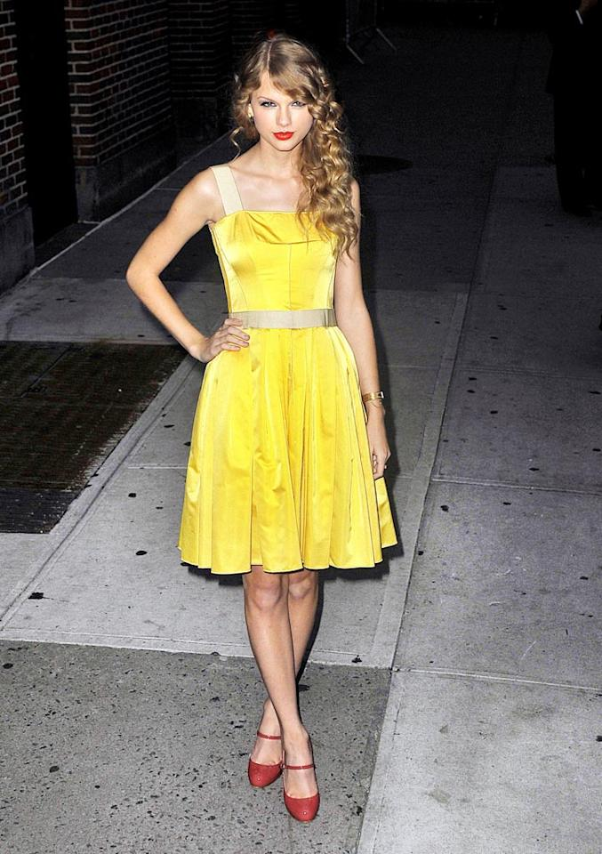 "Selena's BFF, Taylor Swift, popped a serious ""Blue Steel"" pose before heading into NYC's Gotham Hall, where she held a private concert for her fans Tuesday evening. The <i>Speak Now</i> songstress was ethereal in a sunshine yellow Dolce & Gabbana frock, bright red lips, and matching Mary Janes. Ahmad Elatab-SaleemElatab/<a href=""http://www.splashnewsonline.com"" target=""new"">Splash News</a> - October 26, 2010"
