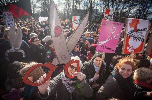 "Polish feminists hold placards reading ""Cut the Cord"" (between the State and the Church) during a march in Warsaw this month. The anti-clerical Palikot Movement stormed into parliament in October elections, taking third spot in the polls and 40 out of the 460 seats"