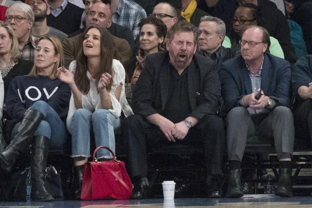 "James Dolan, seen here enjoying what he has wrought, says he has no plans to sell the <a class=""link rapid-noclick-resp"" href=""/nba/teams/nyk"" data-ylk=""slk:New York Knicks"">New York Knicks</a>. (AP)"