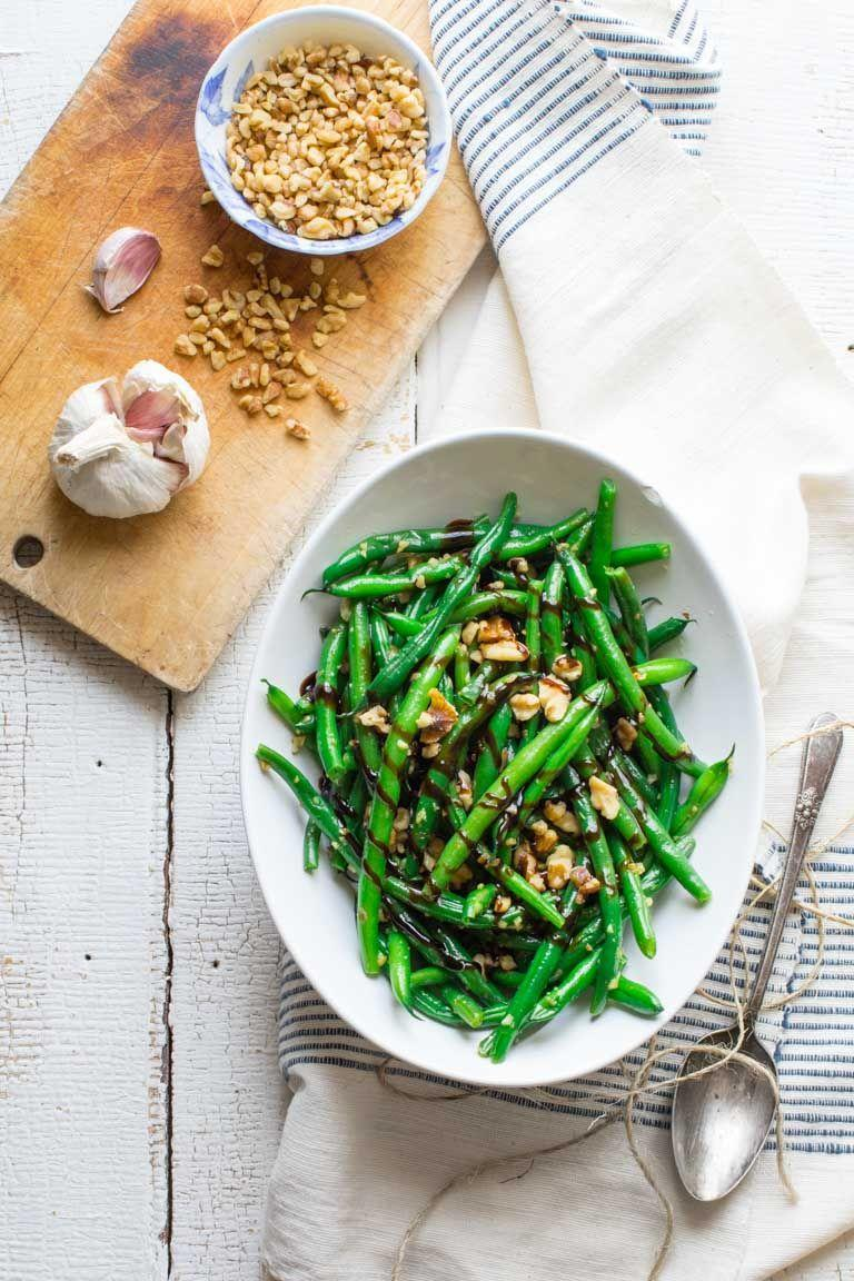 """<p>Vegetarians, rejoice! We found a green bean recipe without bacon!</p><p><strong>Get the recipe at <a href=""""https://www.healthyseasonalrecipes.com/green-beans-with-walnuts-and-balsamic/"""" rel=""""nofollow noopener"""" target=""""_blank"""" data-ylk=""""slk:Healthy Seasonal Recipes"""" class=""""link rapid-noclick-resp"""">Healthy Seasonal Recipes</a>.</strong> </p>"""