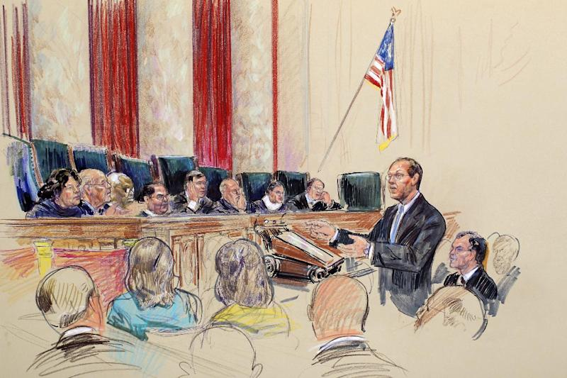"""This artist rendering shows Paul Clement, arguing for Arizona, before the Supreme Court in Washington, Wednesday, April 25, 2012, during the court's hearing on Arizona's """"show me your papers"""" immigration law. Justices, from left are, Sonia Sotomayor, Stephen Breyer, Clarence Thomas, Antonin Scalia, Chief Justice John Roberts, Anthony Kennedy, Ruth Bader Ginsburg, and Samuel Alito. (AP Photo/Dana Verkouteren)"""